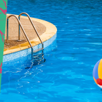 Photo of pool with beach ball floating in the water