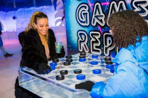 two women beat the heat at ice bar