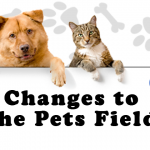 dog and cat behind sign that reads change to pets field