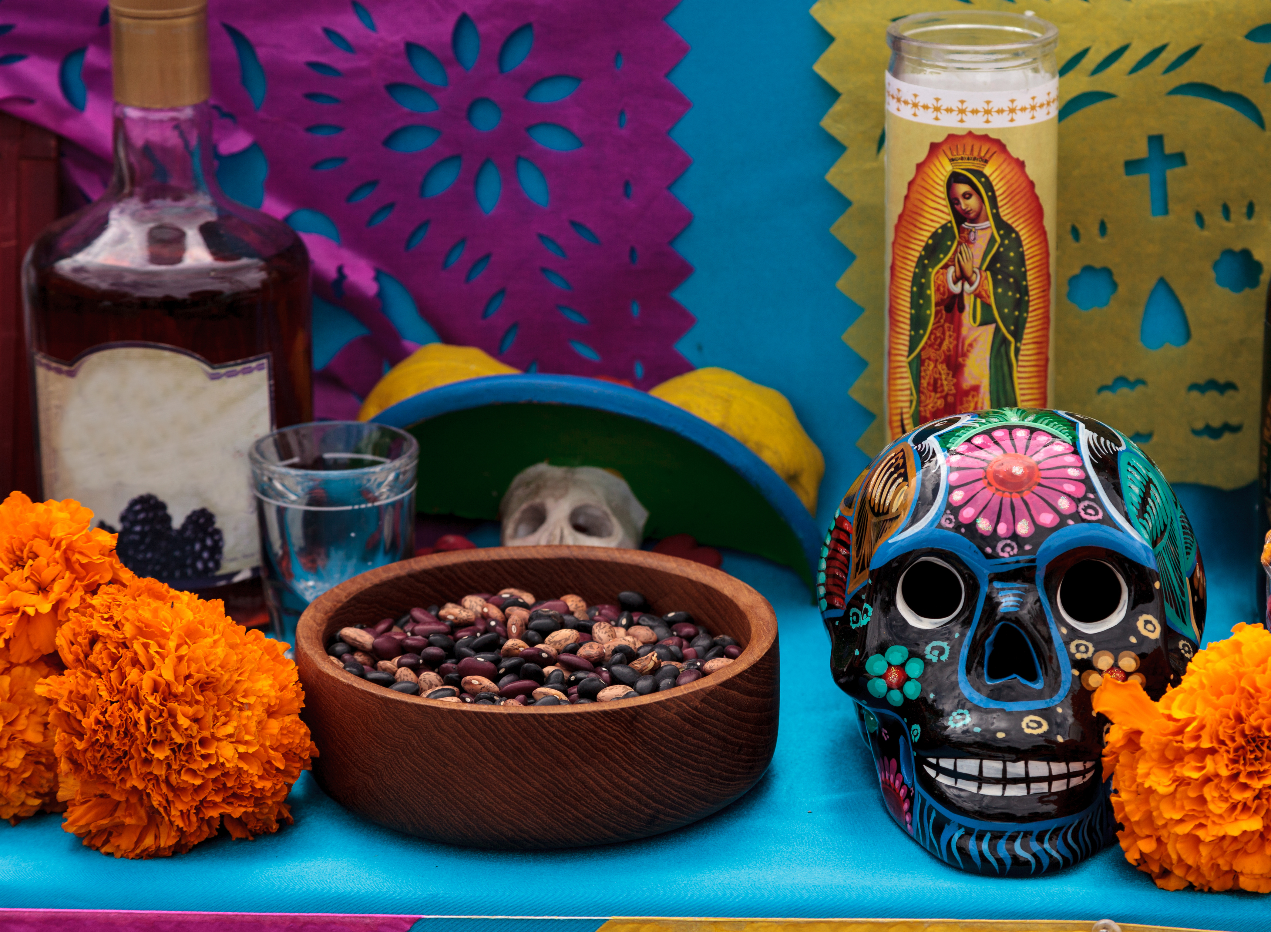 Dia de los Muertos alter of candles, food and flowers