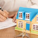 Raster image of hands signing a contract with a miniature house and keys in front of it