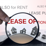 Raster hand holding magnifying glass over vector houses with rent and lease terms in background