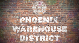 Brick wall with the words Phoenix Warehouse District